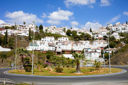 housing styles: Roundabout in Punta Lara Pueblo Blanco on Costa del Sol, near resort town of Nerja in southern Andalucia, Malaga province, Spain.