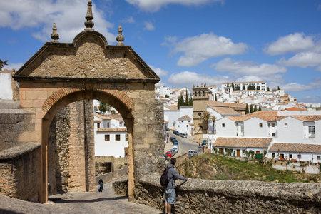 The Felipe V Arch (Spanish: Arco de Felipe V) to the Old Bridge (Spanish: Puente Viejo) in Ronda, Andalusia region, Malaga province, Spain.