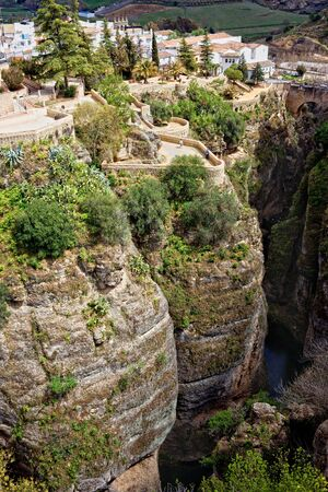 Ronda town on the high cliffs of Ronda Gorge in Andalucia region of Spain, Malaga province  photo