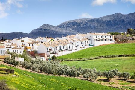 new development: Residential real estate development in Ronda town, new apartment houses on a green hills of Andalusia in southern Spain, Malaga province