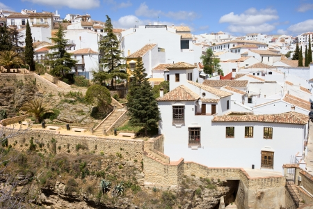 blanco: Old Town of Ronda historic architecture in Andalusia region, traditional Pueblo Blanco on a hill in southern Spain.