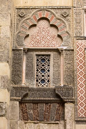 Islamic decoration on a facade of the Mezquita (Cathedral of St. Mary of the Assumption) in Cordoba, Spain. photo