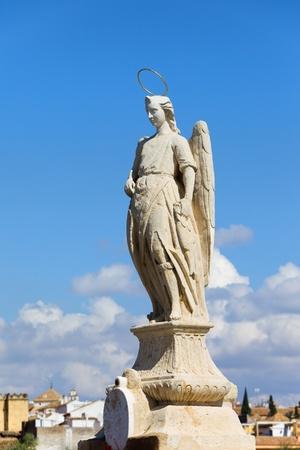 gomez: Archangel Raphael statue from 1651 by Bernabe Gomez del Rio on the Roman Bridge in Cordoba, Spain.