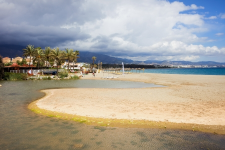 Costa del Sol in Spain, sandy beach located between Marbella and Puerto Banus, waters of Green River (Spanish: Rio Verde) and Mediterranean Sea.