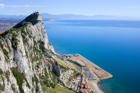 Gibraltar Rock steep cliff by the Mediterranean Sea in southern part of Iberian Peninsula.