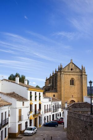 Picturesque street in the medieval old town of Ronda leading to the Church of the Holy Spirit, located in Spain, Andalusia region. Stock Photo - 14825585
