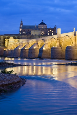 Roman Bridge on Guadalquivir river and The Great Mosque (Mezquita Cathedral) at dawn in the city of Cordoba, Andalucia, Spain.