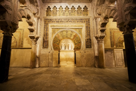 arched: 10th century horseshoe arched Mihrab in the Prayer Hall of 8th century the Great Mosque (Mezquita Cathedral) in Cordoba, Andalusia, Spain.