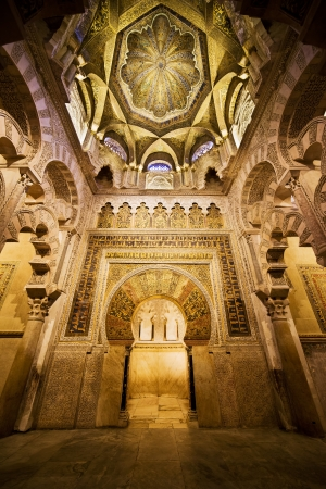 Mihrab (prayer niche) and gilded domed ceiling of 8th century The Great Mosque (Mezquita Cathedral) marvellous interior in Cordoba, Andalusia, Spain.