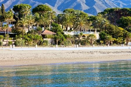 Marbella sandy beach coastline summer holiday scenery by the Mediterranean Sea in Spain, Andalusia region, Costa del Sol, Malaga province. photo