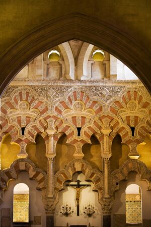 architectural heritage of the world: Muslim ornate interior architecture of Capilla de Villaviciosa in The Great Mosque  Mezquita Cathedral  with Christian crucifix in Cordoba, Spain  Editorial