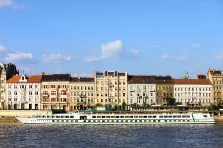 tenement: Tenement houses historic residential architecture by the Danube river in Budapest, Hungary. Stock Photo