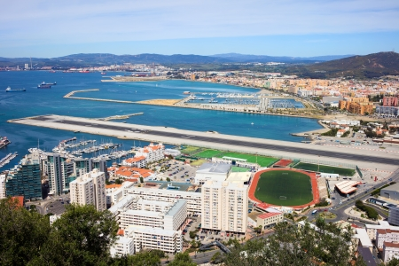 Gibraltar city and airport runway and La Linea de la Concepcion in Spain.