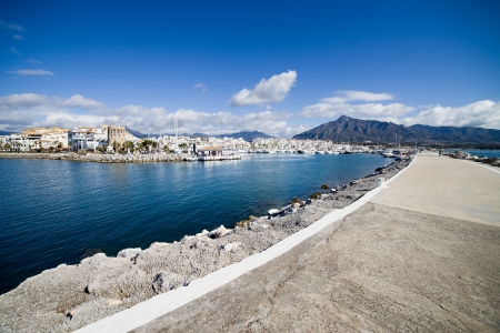 Entrance to the Puerto Banus marina near Marbella and a long pier on Costa del Sol, Andalusia, southern Spain. photo