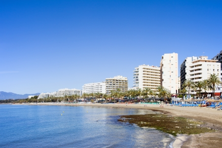 condominium complex: Beach and apartment buildings in resort town of Marbella on Costa del Sol in Spain, Andalusia, Malaga province.