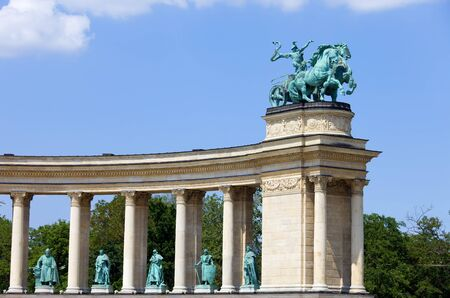 Millennium Monument on the Heroes Square in Budapest, Hungary with God of War statue (inner top edge of the left colonnade). photo