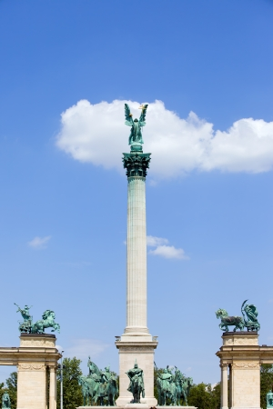 magyar: Millennium Monument in Budapest, Hungary with statue of Archangel Gabriel on Corinthian column, Magyar chieftains at the bottom, flanked by Peace and War charriots.