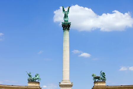 Millennium Monument on the Heroes Square in Budapest, Hungary with statue of Archangel Gabriel on Corinthian column flanked by Peace and War charriots. photo