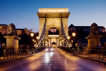 szechenyi: City of Budapest in Hungary night urban scenery, street on the Szechenyi Chain Bridge (Hungarian: Szechenyi lanchid). Stock Photo