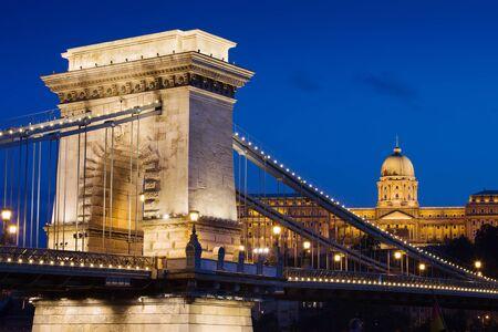 szechenyi: Szechenyi Chain Bridge (Hungarian: Szechenyi lanchid) and Buda Castle at night in the city of Budapest, Hungary.