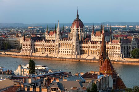 Hungarian Parliament Building at sunset in the city of Budapest, Hungary. photo