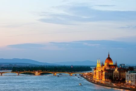 neogothic: Budapest at dusk with Hungarian Parliament Building and Margaret Bridge on Danube river.