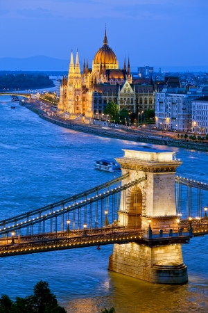 hungary: River view of Budapest at evening, illuminated Chain Bridge and Parliament Building.