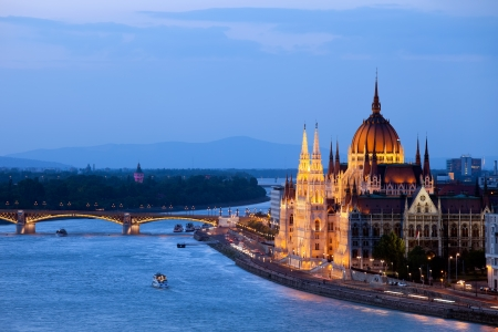 Hungarian Parliament Building and Danube river at evening in Budapest, Hungary. photo
