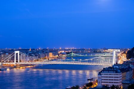 View over the Budapest city at twilight with illuminated bridges over the Danube river in Hungary. photo