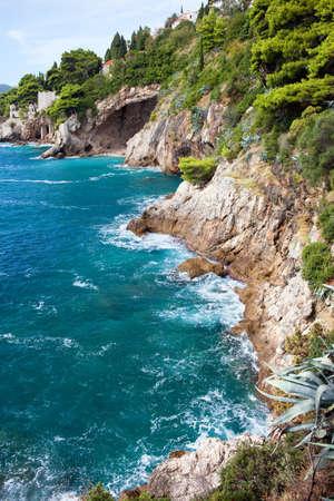 adriatic sea: Cliffs on the Adriatic Sea scenic coastline near Dubrovnik in Southern Croatia, Dalmatia region. Stock Photo