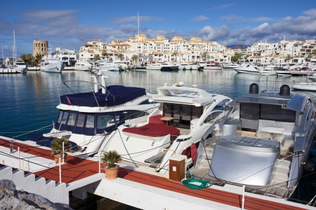 Marina with luxury yachts in resort town of Puerto Banus on Costa del Sol in Spain, near Marbella, Andalusia region. photo
