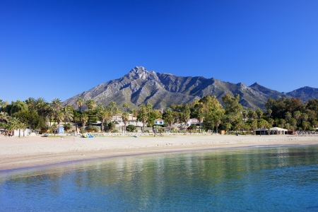 del: Marbella sandy beach, summer holiday scenery by the Mediterranean Sea in Spain, Andalusia region, Costa del Sol, Malaga province.