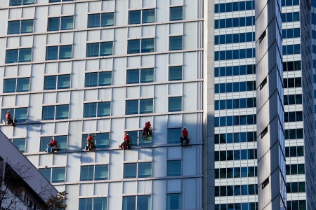 cleaning crew: Office buildings modern facades and team of window cleaners in Warsaw downtown, Poland.