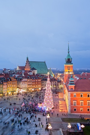 Old Town of Warsaw in Poland illuminated at evening, during Christmas time, composition with free space. photo