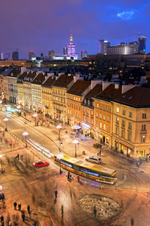 City life on Krakowskie Przedmiescie street at evening in Warsaw, Poland. photo