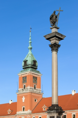 17th century King Sigismund III Vasa statue on top of the Corinthian column and Royal Castle in Warsaw, Poland. photo