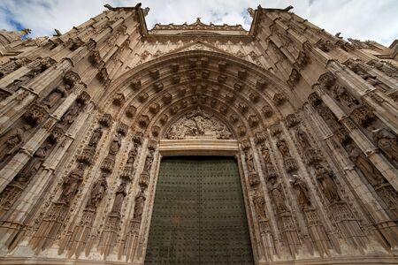 main gate: Door of Assumption (Spanish: Puerta de la Asuncion) of the Sevilla Cathedral (Spanish: Catedral de Santa Maria de la Sede) in Spain, main portal of the west facade.