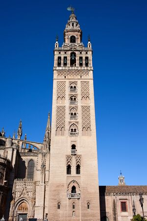 La Giralda, bell tower of the Seville Cathedral in Spain, Almohad and Renaissance architectural styles. Stock Photo