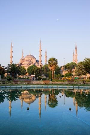 Dawn at the Blue Mosque (Sultan Ahmet Camii) with reflection on water in Sultanahmet district, city of Istanbul, Turkey. photo