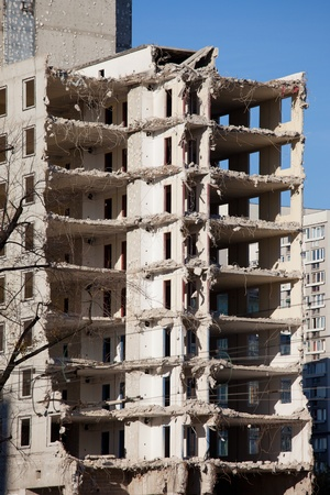 Halfway finished demolishing of a multi-storey old apartment building in Warsaw, Poland. photo