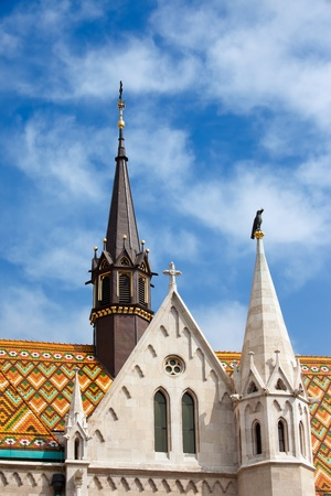 Spires And Diamond Shape Roof Tiles Of The Matthias Church In Budapest,  Hungary. Photo