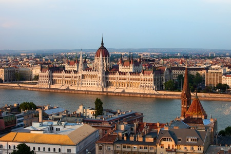 Hungarian Parliament Building at sunset by the Danube river in the city of Budapest, Hungary. photo
