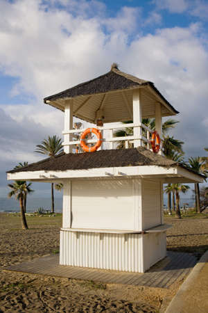 Lifeguard tower on a beach in Marbella, Costa del Sol, Andalusia, Spain.