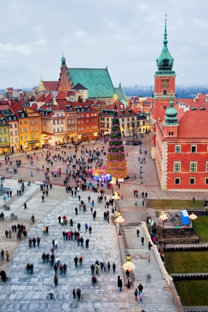 Castle Square in the Old Town of Warsaw in Poland, illuminated at evening during Christmas time.