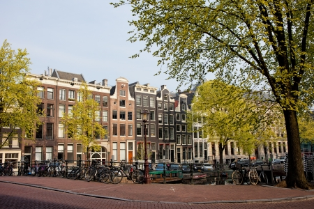 Singel canal historic row houses in the city of Amsterdam, Netherlands photo
