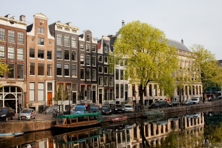 tree linked: Historic, traditional houses along the Singel canal in spring, city of Amsterdam, Netherlands.