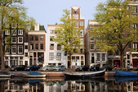 sights: Picturesque traditional houses on Singel canal, city of Amsterdam, Holland. Stock Photo