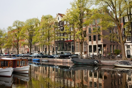 Houses along the Singel canal in the city of Amsterdam, Holland. photo