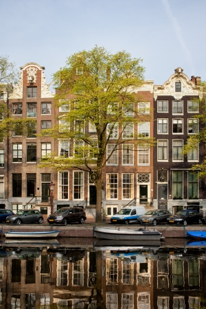 Singel canal historic terraced houses in the city of Amsterdam, Netherlands. photo