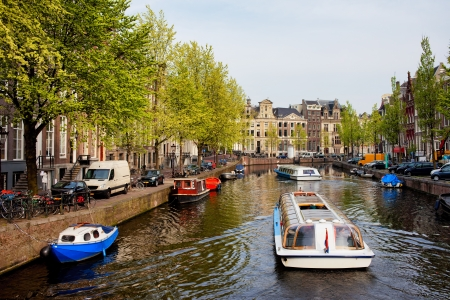 Passenger boats on canal tour in the city of Amsterdam, Holland. photo